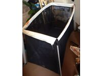 Phil & Teds Traveller, the only full size cot/crib thats lighter than the baby