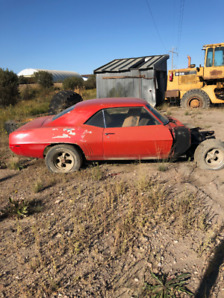 1969 Camaro project car with parts