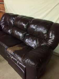 Leather couch & love seat for shop or rec room