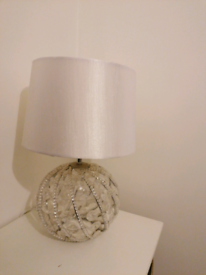 White/ ivory coloured lamp shade with a clear beaded effect base.