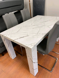 5. X display marble table and 4 grey leather chairs