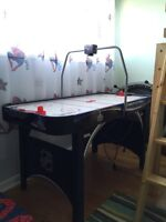 Air hockey table with electronic scoring board