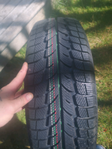 Set of 4 Brand new winter tires (205 65r16)