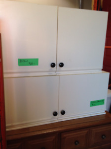 2 White Cabinets & light brown Pantry