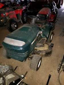 Craftsman riding mower with snow blower attachment.