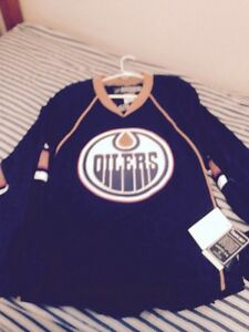 Oilers jersey (size 50) and Edmonton Eskimos size small