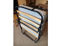 Folding single guest bed.