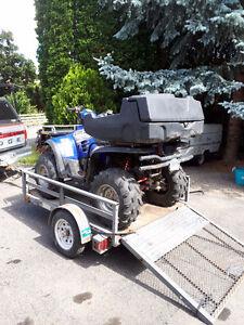 Polaris 700 twin 4x4 ATV with wrap around seat