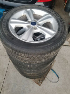 235 55 17 all season tires on Ford Escape alloy rims 5x108 TPMS
