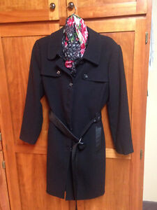 Black coat with scarf accessory