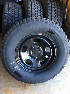 "4 P265/70R17 Studded Snow Tires On 17"" Factory Dodge Ram Wheels"