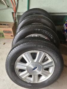 4 MICHELIN X RADIAL 215/60R16  ALL SEASON TIRES WITH MAGS 250$