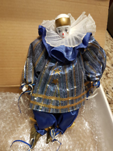 porcelain and fabric clown doll