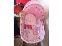 Baby girl Moses basket with stand and matching cot quilt and bumper.