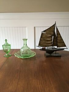 Green depression glad and metal ship decor