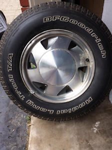 Set of 4 tires and rims for a small GMC truck