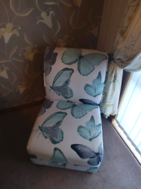 White and teal fabric chair
