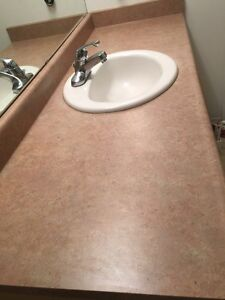 Laminate countertop with white sink and Chrome faucet