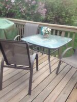 Glass top patio set with 4 chairs.