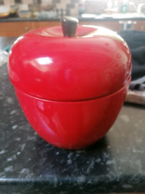 Red apple ornament for storage.