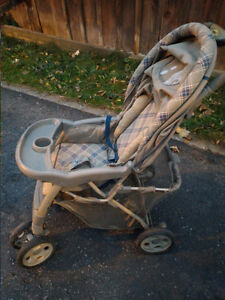 Stroller, foldable, with a bottom bin, cup holder and hood