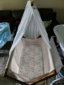 Timber covered baby bassinet