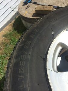 Four tires and aluminum rims for sale