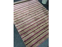 Large wool rug. New.