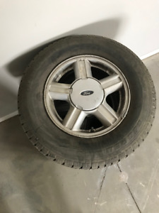 P215 75R15 tires and Ford factory rims for sale