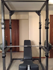 Power Rack, Bench, and 300 lb Olympic Weight Set