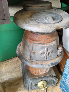 Small pot belly Wood burning Stove 30 A about 2 ft x 1 ft