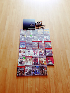 black sony ps3 slim console and assorted ps3 games