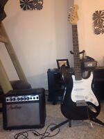 ELECTRIC GUITAR WITH AMP AND STAND!GREAT CONDITION!