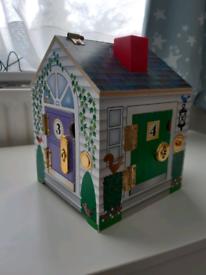 Play house with door bells and keys to 4 doors