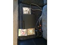 PS3 with two controllers and three games