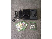 Xbox One (plus controller, headset, Fifa 17, Batman Arkham Knight, Fifa 15 and 16)