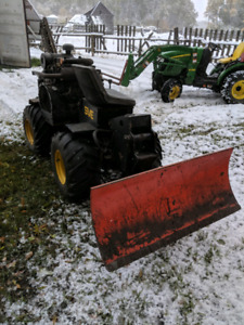 Bobcat chain trencher with backfill blade
