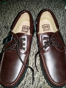 BRAND NEWMens shoes size 9.5