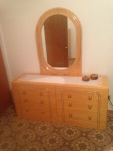 Two bedroom dressers with mirror