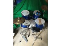 Performance Percussion drum kit with two sets of drum stick and ear defenders