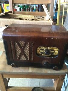 Antique radios, tobacco tins, signs, bottles, toys, old Windows