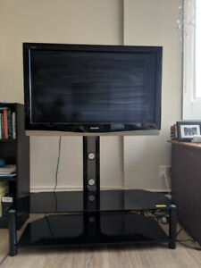 "42"" Flat Screen TV and Beautiful Black Stand"