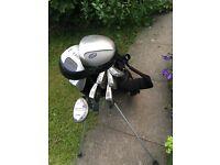 Beginner golf clubs and Wilson stand bag