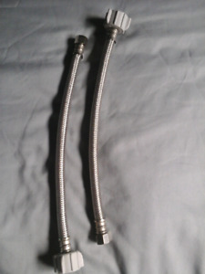 Two stainless flex hoses