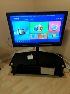 For sale.  40 inch Sony TV with TV stand $150 obo