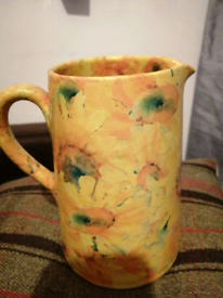 For sale yellow jug for sale and a vase peach yellow green nice I