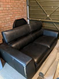 Natuzzi black leather sofa