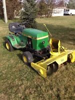 John Deere 111 tractor with snowblower and cutting deck.