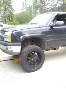 Like new 37 inch tires and 24 inch wheels