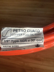 "50' coil of 3/8"" petroguard orange jacketed copper fuel-oil tube"